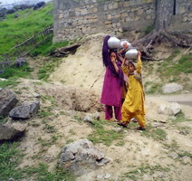 Little girls carrying water down from a spring in the foothills of the Hindukush.