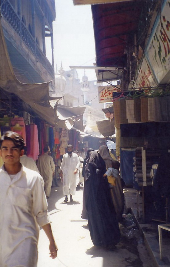 Chowk Yadgaar, bazaar with the old Mughal (17th C) Mosque rising in the background.
