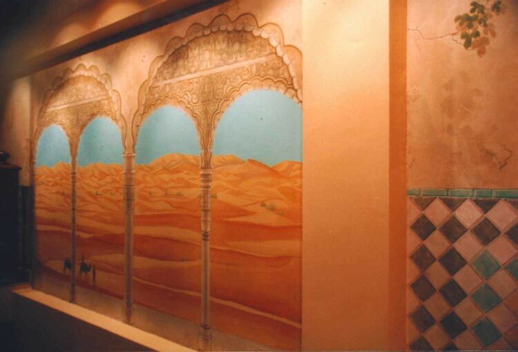 Mural: Beside the tile mural a view from the arches of the Alhambra of the Sahara desert crossed by bedouins.