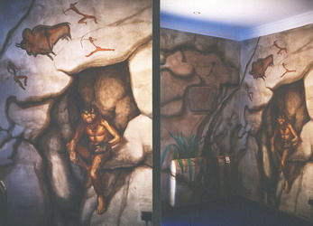 This humorous mural was inspired by the original carved Neolithic stone embedded in the wall- centre-left of photo on the right.