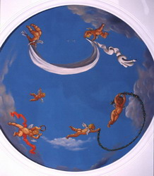 Angels painted in a cupola of a domed bathroom.