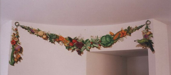Trompe l'oeil vegetable garland with parrot.