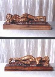 Sculpture- clay figure w/gold leaf & tar polychroming, 30 cm long.