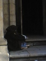 Beggar on the church steps