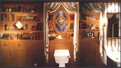 I painted this little powder room (approx 2 x 3 m) with trompe l'oeil bookshelves of faux bois, in an acrylic base & oil finish. Above, three walls pieced together in a single two-dimensional image.