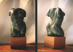 Front & back of 1 of an edition of 2 bronzes poured from a clay model, on a walnut base. 15 cm tall