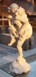 The clay maquette to see it in three dimensions before committing to the many hours the final wood sculpture would take